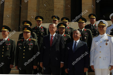 Recep Tayyip Erdogan, Ismet Yilmaz Turkish Prime Minister Recep Tayyip Erdogan, front-center left, Defense Minister Ismet Yilmaz, front-second right, and army commanders follow a guard of honour at the mausoleum of Turkey's founder Mustafa Kemal Ataturk before a meeting of High Military Council in Ankara, Turkey, . Erdogan joined top commanders for one of the military's most important meetings to promote officers or dismiss others for disciplinary reasons