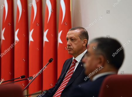 Recep Tayyip Erdogan, Ismet Yilmaz Turkish Prime Minister Recep Tayyip Erdogan, rear, is flanked by his Defense Minister Ismet Yilmaz during a meeting of High Military Council with army commanders in Ankara, Turkey, . Erdogan joined top commanders for one of the military's most important meetings to promote officers or dismiss others for disciplinary reasons