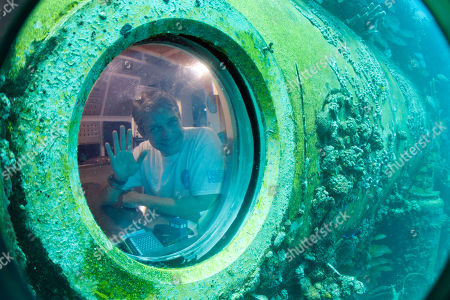 "Fabien Cousteau Fabien Cousteau waves from inside Aquarius Reef Base, a laboratory 63 feet below the surface in the waters off Key Largo, in the Florida Keys National Marine Sanctuary, . A team of filmmakers and researchers dove with Cousteau on June 1 to Aquarius. At the mission's mid-point, the FIU researchers traded places with researchers from Northeastern, who will return to land July 2 with Cousteau. They've been studying the effects of climate change and pollutants such as fertilizers on the reef. Cousteau conceived of ""Mission 31"" as an homage to the Conshelf underwater living experiments orchestrated in the 1960s by his grandfather, ocean exploration pioneer Jacques Cousteau"