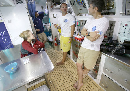 Grace Young, Ryan Stancil, Fabien Cousteau Mission scientist Grace Young, left an MIT graduate in Mechanical & Ocean Engineering, Ryan Stancil, center, Mission doctor, and Fabien Cousteau chat inside Aquarius Reef Base, a laboratory 63 feet below the surface in the waters off Key Largo, in the Florida Keys National Marine Sanctuary, . A team of filmmakers and researchers dove with Cousteau on June 1 to Aquarius. At the mission's mid-point, the FIU researchers traded places with researchers from Northeastern, who will return to land July 2 with Cousteau. They've been studying the effects of climate change and pollutants such as fertilizers on the reef