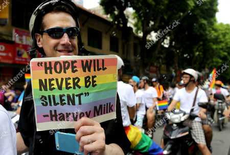 LGBT (lesbian, gay, bisexual and transgender) human rights activist Stuart Milk holds up a sign, quoting his uncle, civil rights leader Harvey Milk as he joins in a bike rally in Hanoi, Vietnam on . About a thousand people participated in Hanoi's annual gay pride bike rally on Sunday in a rare show of support for equal rights and same-sex marriage
