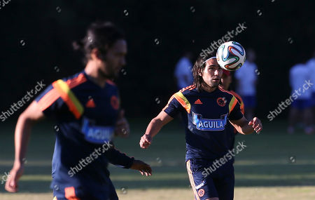 Radamel Falcao, Eder Alvarez Balanta Colombia's player Radamel Falcao, right, trains with teammate Eder Alvarez Balanta in Buenos Aires, Argentina, . Colombia's national soccer team is hoping Falcao will be able to play at the World Cup after his knee injury. Brazil is hosting the international soccer tournament starting in June