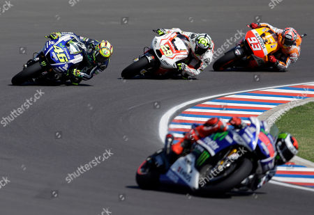 Stock Photo of Valentino Rosi, Jorge Lorenzo, Marc Marquez, Andrea Iannone MotoGP rider Italy's Valentino Rossi, left, streets his Yamaha ahead of Italy's Andrea Iannone and Honda's Marc Marquez, right, of Spain, as Spain's Jorge Lorenzo leads the pack during the Argentina's Motorcycle Grand Prix at the Termas de Rio Hondo circuit, Argentina