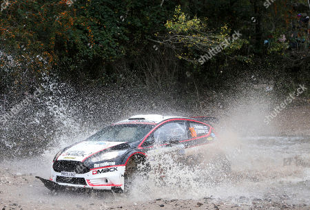 Jari Ketomaa, Kaj Lindstrom Driver Jari Ketomaa and his co-driver Kaj Lindstrom, both from Finland, steer their Ford Fiesta in stage 3 of the first day of the FIA WRC Argentina Rally in Agua de Oro, Argentina