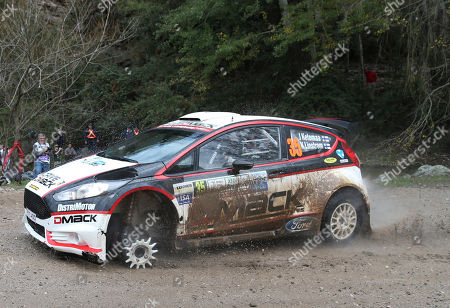 Jari Ketomaa, Kaj Lindstrom Driver Jari Ketomaa and his co-driver Kaj Lindstrom, both from Finland, stop their Ford Fiesta after blowing a tire during stage 3 of the first day of the FIA WRC Argentina Rally in Agua de Oro, Argentina