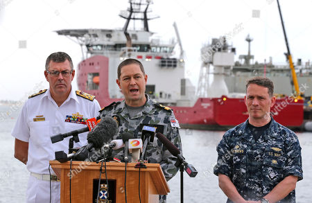 Mark Matthews Peter Leavy Ray Griggs U.S. Navy Captain Mark Matthews right, Royal Australian Navy Commodore Peter Leavy commander of join task force 658, center, and Chief of the Navy Vice Admiral Ray Griggs speak at a press conference at naval base HMAS Stirling about the Defense ship Ocean Shield and her roll in the search for missing Malaysia Airlines Flight MH370 in Perth, Australia