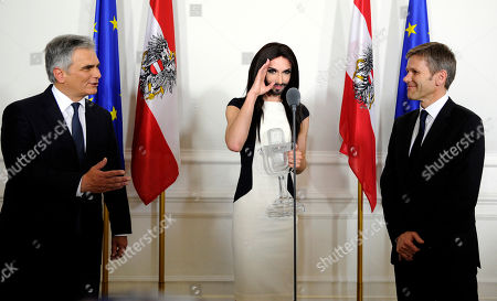 Conchita Wurst, Werner Faymann, Josef Ostermayer Austrian Federal Chancellor Werner Faymann, left, and Federal Minister for Arts and Culture Josef Ostermayer, right, welcome Austrian singer and Eurovision Song Contest winner Conchita Wurst at the federal chancellery in Vienna, Austria on . The bearded drag queen Conchita Wurst had made a triumphant return to Austria last week after winning the Eurovision Song Contest in Copenhagen in what the country's president called a victory for tolerance in Europe
