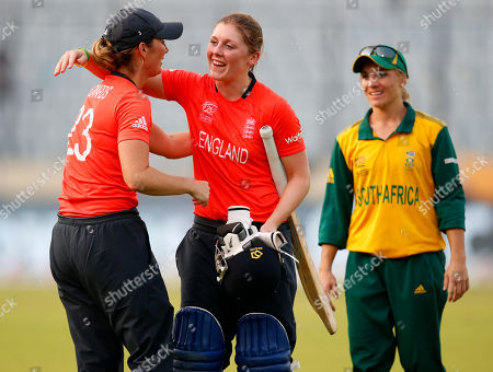 Stock Image of Mignon Du Preez, Charlotte Edwards, Heather Knight South Africa's captain Mignon Du Preez, right, watches England captain Charlotte Edwards, left, greet teammate Heather Knight on their win in the ICC Women's Twenty20 Cricket World Cup semi-final match in Dhaka, Bangladesh, . England won the match by nine wickets