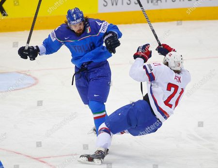 Morten Ask, Daniel Sullivan Italy's Daniel Sullivan, left, crashes into Norway's Morten Ask during the Group A preliminary round match between Italy and Norway at the Ice Hockey World Championship in Minsk, Belarus