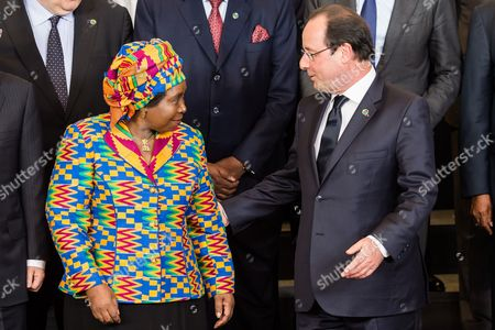 Francois Hollande, Nkosazana Clarice Dlamini Zuma French President Francois Hollande, right, and African Union Commission Chairperson Nkosazana Clarice Dlamini Zuma talk as they pose for a group photo with other EU and African leaders during an EU Africa summit at the EU Council building in Brussels on . Leaders of some 70 nations from Africa and the European Union are meeting to improve political and economic cooperation between the two continents. The two-day summit in Brussels starting Wednesday also features discussions about development aid, climate change and migration issues