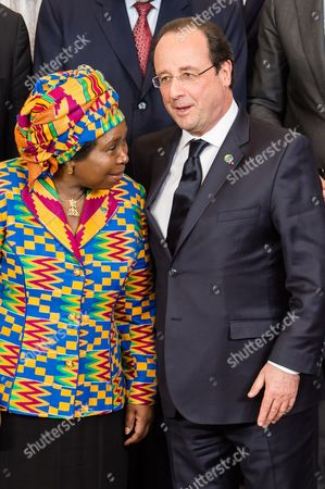 Francois Hollande, Nkosazana Clarice Dlamini Zuma French President Francois Hollande, right, and African Union Commission Chairperson Nkosazana Clarice Dlamini Zuma talk as they pose for a group photo with other EU and African leaders during a EU Africa summit at the EU Council building in Brussels on . Leaders of some 70 nations from Africa and the European Union are meeting to improve political and economic cooperation between the two continents. The two-day summit in Brussels starting Wednesday also features discussions about development aid, climate change and migration issues
