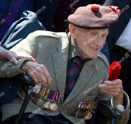 Peter Watson Black Watch World War Two veteran, Peter Watson, 93, from Surrey, England holds a 'Heckle' he received from a fellow soldier as he attends the unveiling of the new World War One Black Watch memorial at Black Watch Corner in Zonnebeke, Belgium, on . The new statue was unveiled to remember the 8,000 dead and more than 20,000 wounded Black Watch soldiers who fought in 1914-1918 war. Black Watch soldiers wear the red heckle in their bonnets which distinguishes them from other Highland regiments