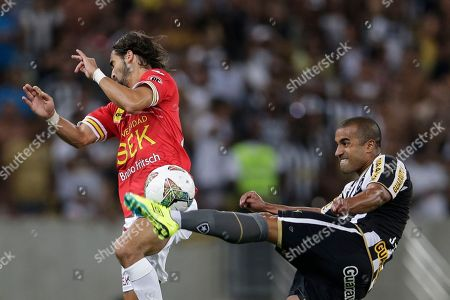 Stock Image of Sebastian Oscar Jaime, Julio Cesar Julio Cesar of Brazil's Botafogo, right, fights for the ball with Sebastian Oscar Jaime of Chile's Union Espanola at a Copa Libertadores soccer match in Rio de Janeiro, Brazil