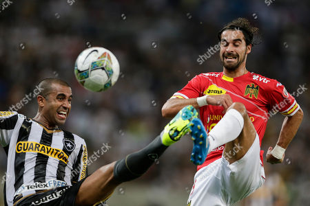 Stock Photo of Sebastian Oscar Jaime, Julio Cesar Julio Cesar of Brazil's Botafogo, left, fights for the ball with Sebastian Oscar Jaime of Chile's Union Espanola at a Copa Libertadores soccer match in Rio de Janeiro, Brazil