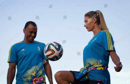 Cafu, Fernanda Lima Former soccer player Cafu, left, watches as Brazilian model Fernanda Lima controls a soccer ball as they present the uniform that will be used by volunteers working at the 2014 World Cup soccer tournament, during Fashion Week in Rio de Janeiro, Brazil, . Brazil will host this year's World Cup