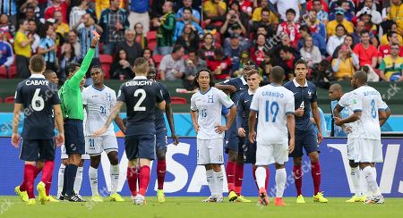 Referee Referee Sandro Ricci from Brazil shows a red card to Honduras' Wilson Palacios, far right, during the group E World Cup soccer match between France and Honduras at the Estadio Beira-Rio in Porto Alegre, Brazil