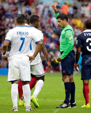 Honduras' Wilson Palacios, second left, is given a red card and ejected from the game by referee Sandro Ricci from Brazil during the group E World Cup soccer match between France and Honduras at the Estadio Beira-Rio in Porto Alegre, Brazil