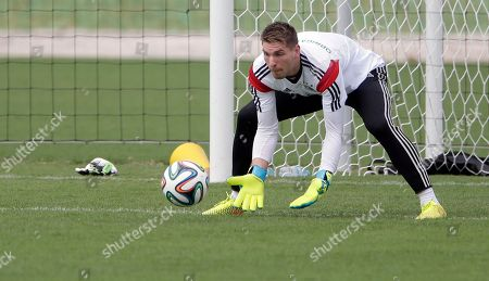 Germany's goalkeeper Ron Robert Zieler catches a ball during a training session near Porto Seguro, Brazil, . Germany will play in group G of the 2014 soccer World Cup