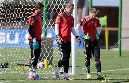 German national soccer goalkeepers Roman Weidenfeller, from left, Manuel Neuer and Ron-Robert Zieler attend a training session in Santo Andre near Porto Seguro, Brazil, . Germany will play in group G of the 2014 soccer World Cup