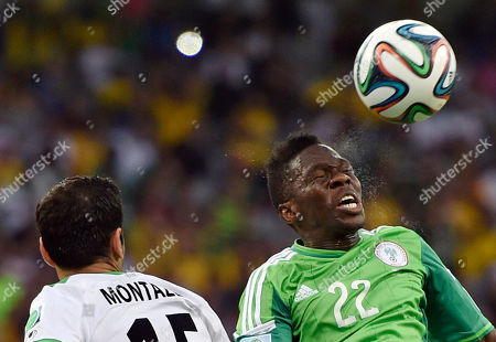 Iran's Pejman Montazeri, left, and Nigeria's Kenneth Omeruo battle for the ball during the group F World Cup soccer match between Iran and Nigeria at the Arena da Baixada in Curitiba, Brazil