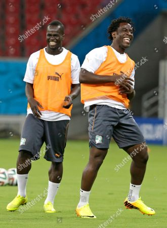 Ivory Coast's Didier Ya Konan, left, and Wilfried Bony smile during an official training session the day before the group C World Cup soccer match between Ivory Coast and Japan at the Arena Pernambuco in Recife, Brazil