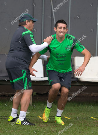 Miguel Herrera, Hector Herrera Mexico's coach Miguel Herrera, left, assists player Hector Herrera during a training session in Santos, Brazil, . Mexico plays in group A at the 2014 soccer World Cup