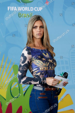 Brazilian model Fernanda Lima attends the launch event of the Football for Hope Festival 2014 at the Caju slum complex, in Rio de Janeiro, Brazil, . The festival also known as the Social World Cup, brings together 32 teams of young leaders from FIFA-supported social community projects from Brazil and around the world for an intercultural exchange and a tournament