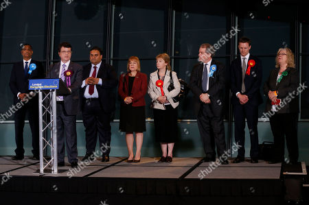 Gerard Batten, Syed Kamall, Mary Honeyball, Lucy Anderson, Charles Tannock, Seb Dance, Jean Lambert Gerard Batten of UK Independence Party, second left, makes a speech after being elected as a MEP during the declaration for the London Region of European Parliament elections at the City Hall in London, . Listen on are the other elected MEPs, from left, Syed Kamall of Conservative Party, Batten, Claude Moraes of Labour Party, Mary Honeyball of Labour Party, Lucy Anderson of Labour Party, Charles Tannock of Conservative Party, Seb Dance of Labour Party and Jean Lambert of Green Party