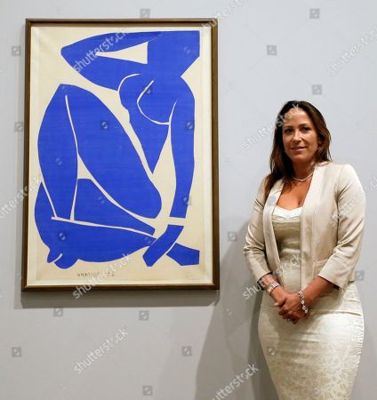 Sophie Matisse, the great-granddaughter of Henri Matisse, stands alongside his work 'Blue Nude III 1952' at The Tate Modern in London, . The artworks are part of the 'Henri Matisse: The Cut-Outs' exhibition that runs at the gallery from April 17 until Sept. 7, 2014