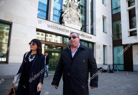 Danny Martin Wilkinson, centre, leaves following a hearing at Westminster Magistrates' Court in London, accused with two other former employees of broker ICAP PLC in the scandal related to the alleged rigging of LIBOR, a key market interest rate. Britain's Serious Fraud Office said the charges against the brokers, Paul Read, Danny Martin Wilkinson and Colin John Goodman stemmed from alleged manipulation of the Yen LIBOR, the Japanese yen version of the benchmark rate