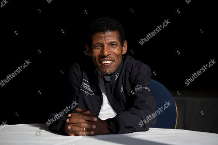 Former marathon world record holder Ethiopia's Haile Gebrselassie, aged 40, who will be the pacemaker for the elite men's runners at the London Marathon, poses for photographers at a hotel in London, . The London marathon takes place on Sunday