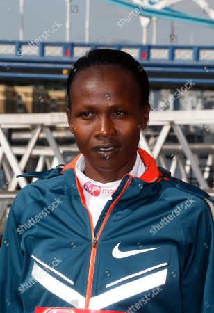 Stock Photo of Elite marathon runner Priscah Jeptoo, of Kenya, poses for the photographers, during a photocall in London, . The London marathon takes place on Sunday, April 13, 2014