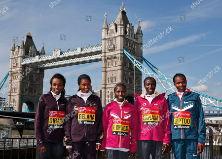 Stock Picture of Elite marathon runners from left to right, Tirunesh Dibaba, Tiki Gelana, both of Ethiopia, Florence Kiplagat, Edna Kiplagat, and Priscah Jeptoo, all of Kenya, pose for photographers, with Tower Bridge in the background, during a photo call in London, . The London marathon takes place on Sunday, April 13, 2014