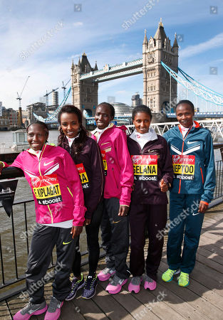 Stock Photo of Elite marathon runners from left, Florence Kiplagat of Kenya, Tirunesh Dibaba of Ethiopia, Edna Kiplagat of Kenya, Tiki Gelana of Ethiopia, and Priscah Jeptoo of Kenya, pose for photographers, backdropped by Tower Bridge during a photocall in London, . The London marathon takes place on Sunday, April 13