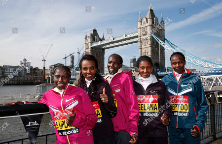 Stock Image of Elite marathon runners from left to right, Florence Kiplagat, of Kenya, Tirunesh Dibaba, of Ethiopia, Edna Kiplagat, of Kenya, Tiki Gelana, of Ethiopia, Priscah Jeptoo, of Kenya, pose for the photographers, backdropped by the Tower Bridge during a photocall in London, . The London marathon takes place on Sunday, April 13, 2014