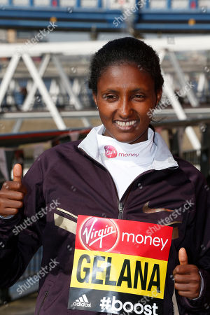 Elite marathon runner Tiki Gelana, of Ethiopia, poses for the photographers, during a photocall in London, . The London marathon takes place on Sunday, April 13, 2014