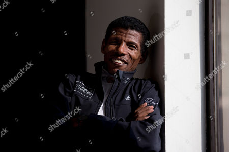 Stock Photo of Former marathon world record holder Ethiopia's Haile Gebrselassie, aged 40, who will be the pacemaker for the elite men's runners at the London Marathon, poses for photographers at a hotel in London, . The London marathon takes place on Sunday