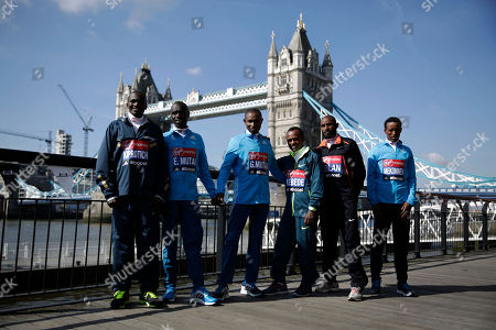 Stock Picture of Elite male marathon runners, from left, Uganda's Stephen Kiprotich, Kenya's Emmanuel Mutai and Geoffrey Mutai, Ethiopia's Tsegaye Kebede, Ibrahiim Jeilan and Tsegaye Mekonnen pose for photographs backdropped by Tower Bridge during a photocall in London, . The London marathon takes place on Sunday