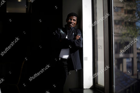 Former marathon world record holder Ethiopia's Haile Gebrselassie, aged 40, who will be the pacemaker for the elite male runners at the London Marathon, poses for photographers at a hotel in London, . The London marathon takes place on Sunday