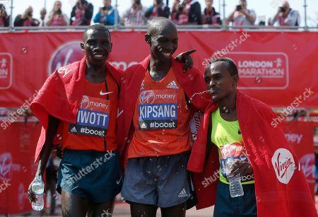 Stock Picture of Wilson Kipsang, Stanley Biwott, Tsegaye Kebede London Marathon winner Wilson Kipsang of Kenya, center, second placed Stanley Biwott of Kenya, left, and third place Tsegaye Kebede of Ethiopia pose at the end of the London Marathon in London
