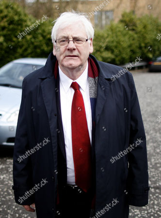 Michael Gallagher whose son Aiden died in the 1998 Omagh bomb leaves Dungannon Court, Northern Ireland, Friday, April, 11, 2014. Gallagher was at court to watch Seamus Daly, 43, from Cullaville, Co Monaghan in the Irish Republic, appear at a sitting after he was charged Thursday evening with 29 counts of murder