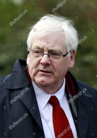 Michael Gallagher, whose son Aiden died in the 1998 Omagh bomb leaves Dungannon Court, Northern Ireland, Friday, April, 11, 2014. Gallagher was at court to watch Seamus Daly, 43, from Cullaville, Co Monaghan in the Irish Republic, appear at a sitting after he was charged Thursday evening with 29 counts of murder