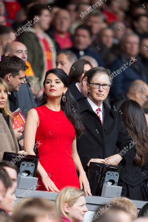 Stock Photo of John William Henry II Liverpool's owner John William Henry II, right, takes his place in the stands alongside his wife Linda Pizzuti before his team's 's English Premier League soccer match against Manchester City at Anfield Stadium, Liverpool, England