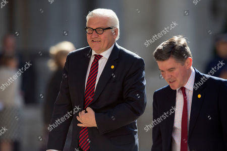"Germany's Foreign Minister Frank-Walter Steinmeier, left, walks with Britain's Minister of State for Foreign and Commonwealth Affairs Hugh Robertson as he arrives to take part of the ""Friends of Syria Meeting"" at the Foreign Office in London"