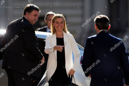 "Italy's Minister of Foreign Affairs Federica Mogherini, center, is greeted by Britain's Minister of State for Foreign and Commonwealth Affairs Hugh Robertson, right, as she arrives to take part in the ""Friends of Syria Meeting"" at the Foreign Office in London"