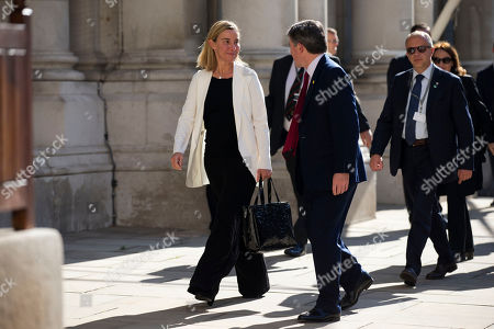 "Italy's Minister of Foreign Affairs Federica Mogherini, left, walks with Britain's Minister of State for Foreign and Commonwealth Affairs Hugh Robertson, second left, as she arrives to take part in the ""Friends of Syria Meeting"" at the Foreign Office in London"