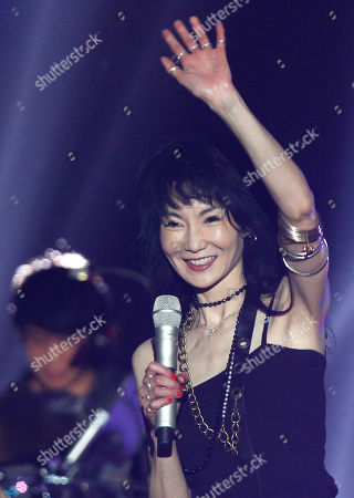 Maggie Cheung Hong Kong actress Maggie Cheung waves to spectators as she sings during a music festival in Shanghai, China