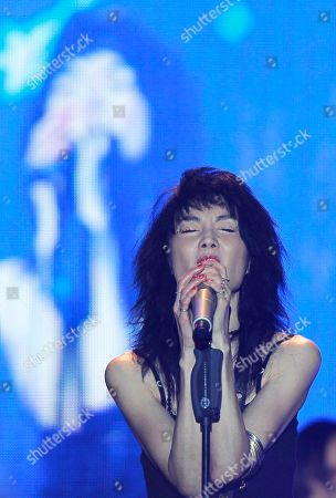 Maggie Cheung Hong Kong actress Maggie Cheung sings during a music festival in Shanghai, China