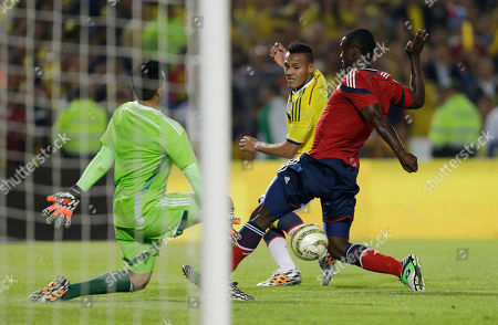Eder Balanta, Camilo Vargas, Aldo ramirez Colombia's Eder Balanta, right, and goalkeeper Camilo Vargas, left, fight for the ball with Aldo ramirez, center, during a send-off exhibition soccer match by the national soccer squad at El Campin stadium in Bogota, Colombia, . Colombia's national soccer team will travel to Argentina where it will continue its preparation for the Brazil 2014 World Cup