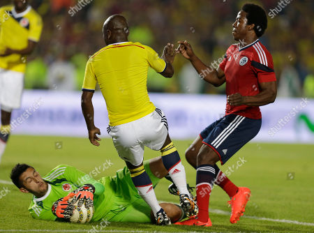 Carlos Sanchez, Camilo Vargas, Pablo Armero Players from Colombia's national team, Carlos Sanchez, right, and goalkeeper Camilo Vargas, on the ground, fight for the ball as Pablo Armero, center, looks on during their send-off exhibition match at El Campin stadium in Bogota, Colombia, . Colombia's national soccer team will travel to Argentina where it will continue its preparation for the Brazil 2014 World Cup